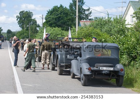 """CHERNOGOLOVKA, MOSCOW REGION, RUSSIA - JUNE 21, 2013: A column of military retro cars is on the side of the road, the 3rd international meeting of """"Motors of war"""" near the city Chernogolovka - stock photo"""