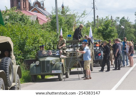 """CHERNOGOLOVKA, MOSCOW REGION, RUSSIA - JUNE 21, 2013:   A column of military retro cars stop on the road, the 3rd international meeting of """"Motors of war"""" near the city Chernogolovka, Moscow region - stock photo"""
