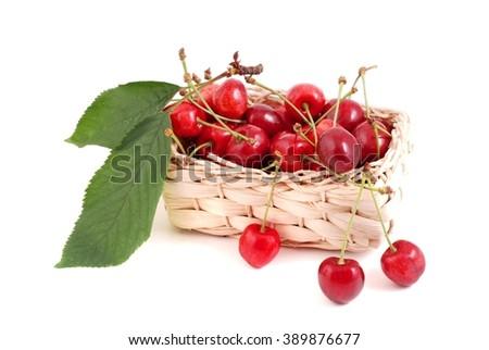 Cherries.Cherries in basket. Fresh cherries. Cherries fruits.Cherries on white background. Cherries with leaves. - stock photo