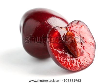 Cherry and half on white background - stock photo