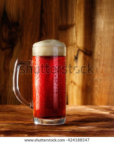 cherry beer on a wooden background - stock photo