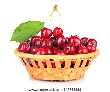 Cherry berries in wicker basket isolated on white - stock photo