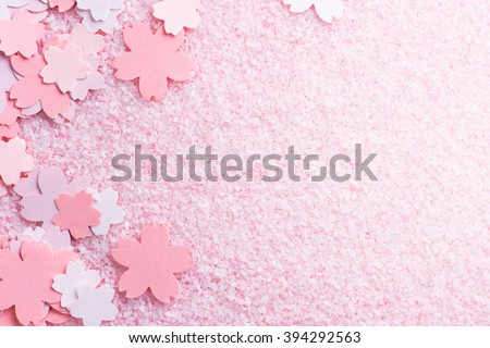 Cherry blossom background image. Cherry blossom pastel pink abstract background fading in to white. Sakura or cherry flower shaped paper cutouts on pink background.  - stock photo