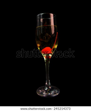 cherry champagne, wine glass,  black background, party - stock photo