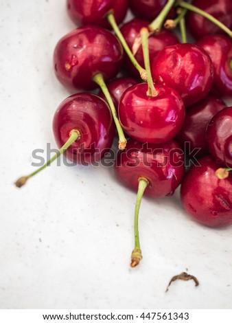 Cherry. Cherries in white plate. Red cherry. Fresh cherries. Cherry on white background. Cherries isolated on white.  - stock photo