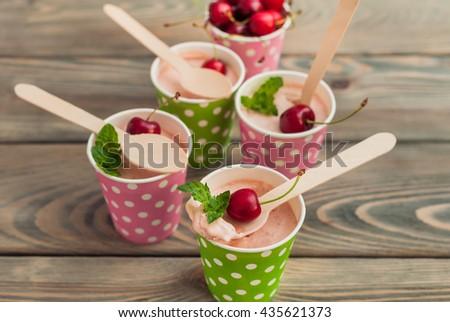 cherry ice cream in paper cup  - stock photo
