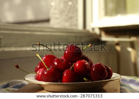cherry in the white plate - stock photo
