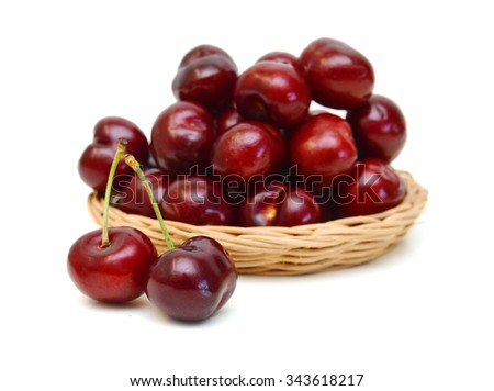 Cherry isolated in basket on white background - stock photo