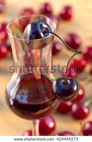 cherry liquor and juicy ripe berries  - stock photo