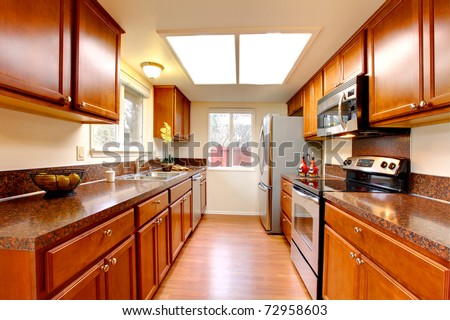 Cherry new kitchen in a simple house - stock photo