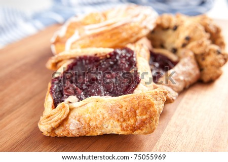 Cherry Puff Pastry Tart, Some Scones and Danish - stock photo