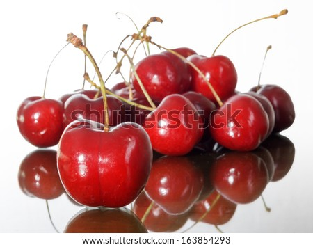 Cherry reflected on the table - stock photo
