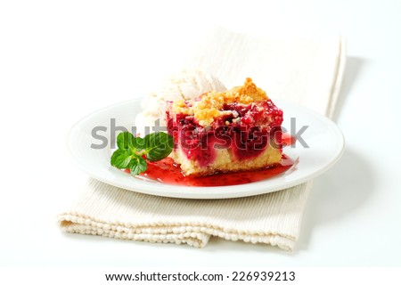 Cherry sponge cake with a scoop of vanilla ice cream - stock photo