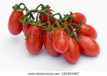 Cherry tomato (plum) of Sicily (Italy) isolated on white background - stock photo