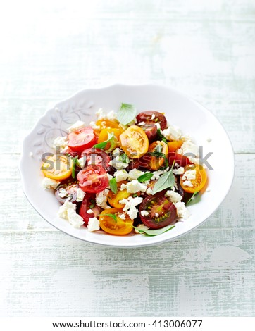 Cherry Tomato Salad with Feta and Basil - stock photo