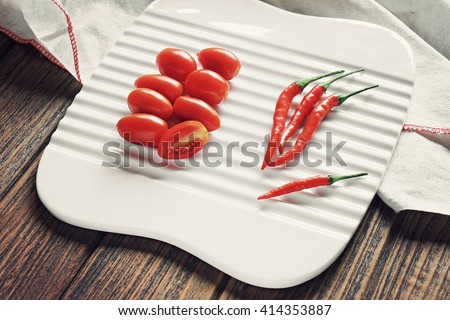 Cherry tomatoes and chilli pepper, Red food, Phytonutrient, Healthy ingredients, Cuisine ingredients. (Color Process) - stock photo