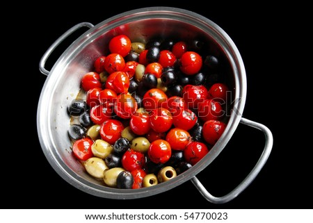 Cherry tomatoes and olives isolated on black - stock photo