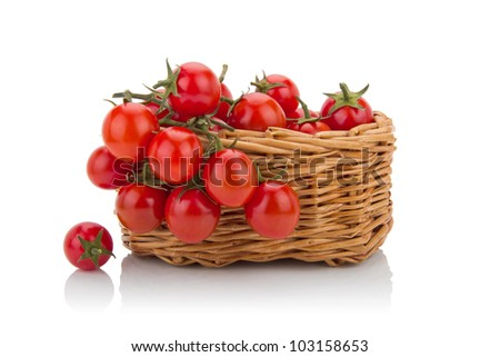 cherry tomatoes isolated  in a basket - stock photo