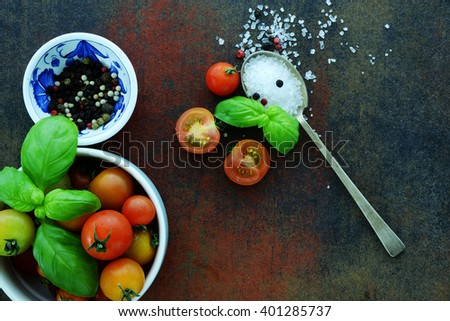 cherry tomatoes with basil and coarse salt for use as cooking ingredients   - stock photo
