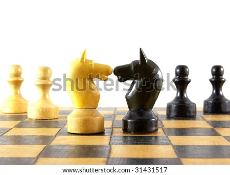 Chess battle on white background - stock photo