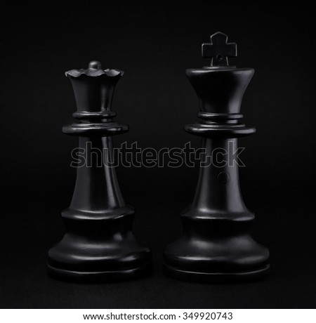 Chess. Black King and Queen on black background .The most powerful figures. Set of chess figures. - stock photo