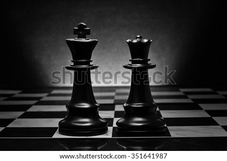 Chess. Black King and Queen on the board .The most powerful figures. Set of chess figures. - stock photo