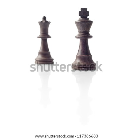 Chess. Black King and Queen out of focus and their shadows reflection on white background. Winner, power, competition or leadership men women concept. - stock photo