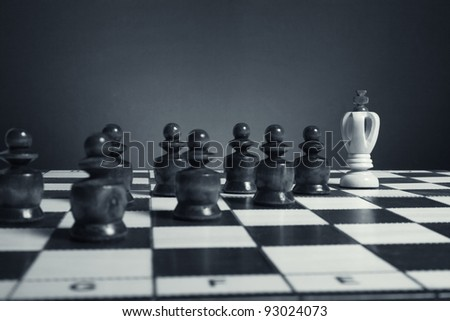 Chess. Black pawns pursue the white king. - stock photo