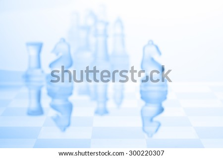 Chess blur focus on blue background - stock photo