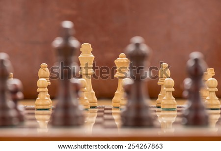 Chess board and pieces set for a game - stock photo