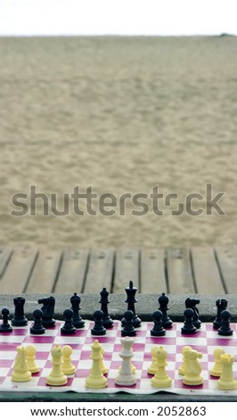 Chess board at the beach - stock photo