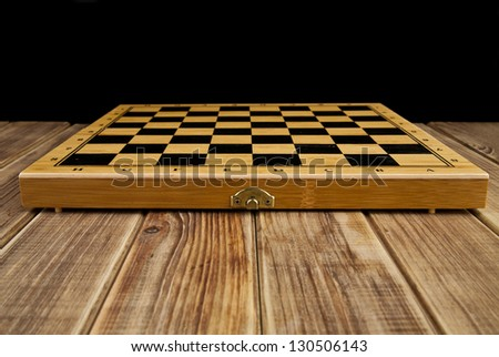 chess-board on a black background - stock photo