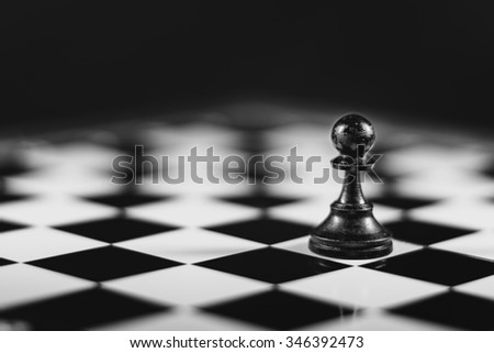 Chess board puzzle game with figures on a special board in the box. - stock photo