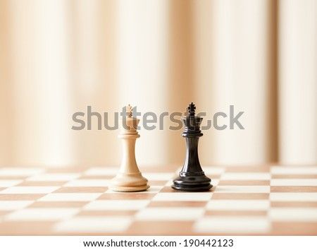 Chess board with chess kings - stock photo