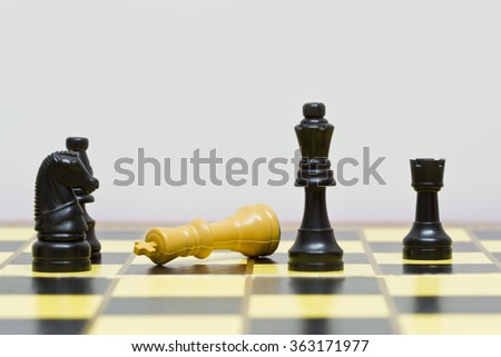 chess board with chess pieces showing a game in progress - stock photo