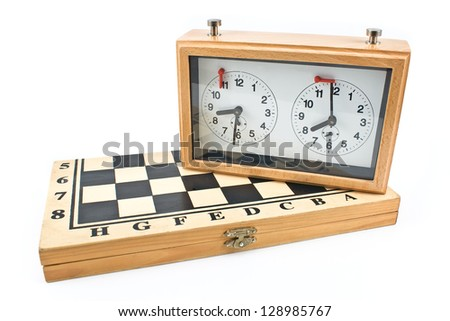 Chess clock on chessboard isolated on white - stock photo
