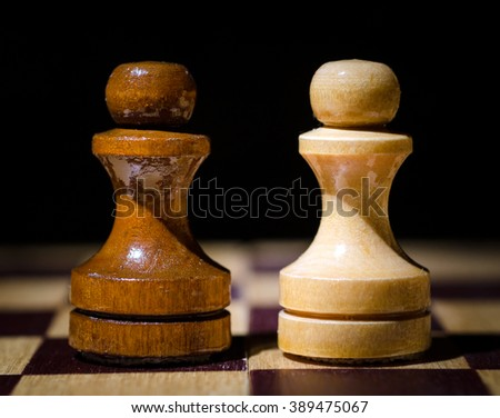 Chess figure two pawn. Close-up on a chess board - stock photo