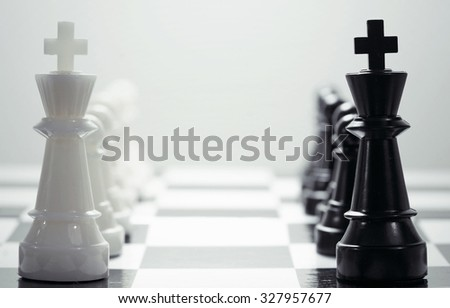 Chess figures on a board - stock photo