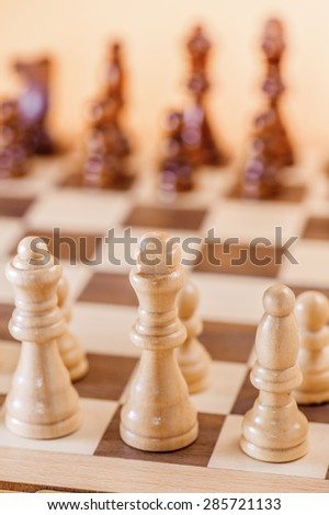 Chess game on wooden brown board. - stock photo