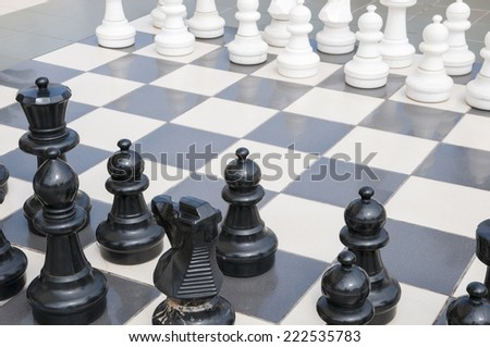 chess game with large pieces - stock photo