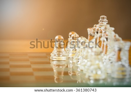 Chess glass start up game for your business competition on chess board. - stock photo