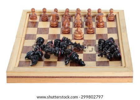 Chess king team leader dominating another in the foreground against a background of black army chips. - stock photo