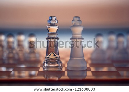 Chess Kings (pawns blurred in background) as a business concept - merger and partnership, or showdown, corporate takeover, strategy, competition, and opposition - confrontation.  - stock photo
