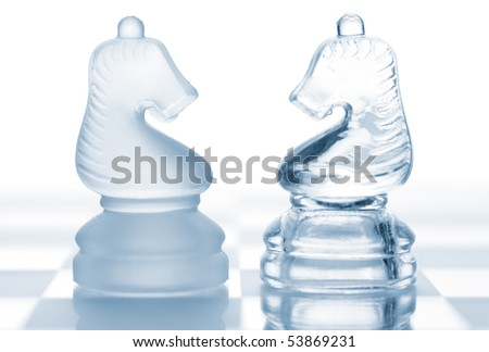 Chess knights. The concept of confrontation - stock photo