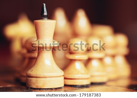Chess leader led king his army white wooden figures. Concept game - stock photo