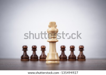 chess leadership concept on the grey background - stock photo