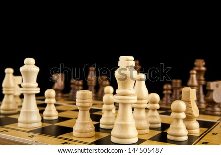 chess on a black background - stock photo