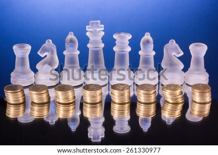 Chess on a coins. Investment strategy. Finance concept. - stock photo