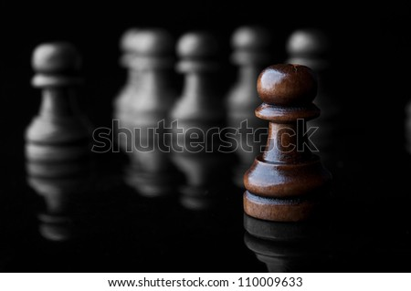 chess pawns isolated on black background - stock photo