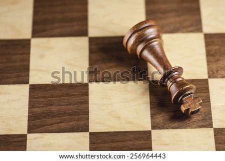 Chess piece and game board background (Shallow Depth-of-Field) - stock photo